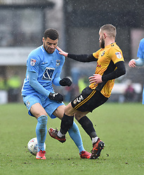 Coventry City's Max Biamou and Newport County's Dan Butler (right)