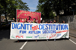 © Licensed to London News Pictures. 29/06/2013. Bristol, UK. A march through Bristol for a national day of Dignity for Asylum Seekers, part of a series of marches today in various UK cities.  The marchers called for an end to forced destitution of asylum seekers, whereby they are not allowed to work, with little or in some cases no state benefits.  29 June 2013.<br /> Photo credit : Simon Chapman/LNP