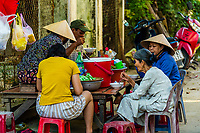 Vietnamese people eating pho (noodles) for breakfast, Hoi An, Vietnam.