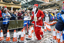 © Licensed to London News Pictures. 07/12/2019. LONDON, UK.  7 December 2019.  A participant takes part in The 39th Great Christmas Pudding Race in Covent Garden, raising funds for Cancer Research as well as having lots of festive fun.  Photo credit: Stephen Chung/LNP