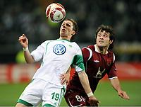 Fotball , 18. mars 2010<br /> Europa League <br /> VFL Wolfsburg - Rubin Kasan<br /> v.l. Peter Pekarik Wolfsburg , Hasan Kasaev<br /> <br /> Norway only