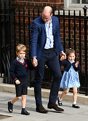 The Duke of Cambridge with Prince George and Princess Charlotte enter the Lindo Wing at St Mary's Hospital in Paddington, London. Photo credit should read: Doug Peters/EMPICS Entertainment