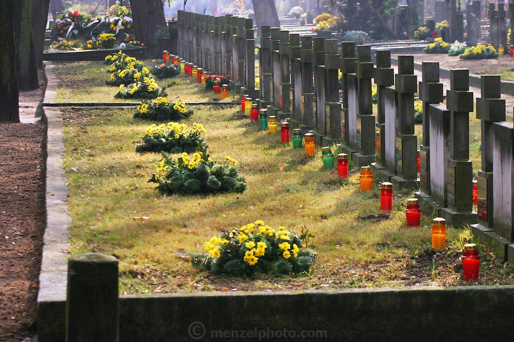 Preparing for All Saints Day. Powazek Cemetery. Warsaw, Poland. Nuns' graves.