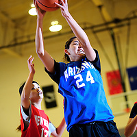 040413       Adron Gardner<br /> <br /> Arizona All-Star and Winslow Bulldog Mattea Begaii (24) puls down a rebound during the girls All-Star game at Miyamura High School in Gallup Thursday.