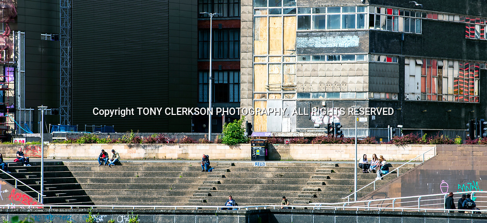 People enjoy the sun by the banks of the River Clyde in Glasgow late summer.