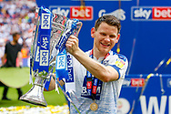 PROMOTED promotion Tranmere Rovers forward Connor Jennings (11) holds the trophy after the EFL Sky Bet League 2 Play Off Final match between Newport County and Tranmere Rovers at Wembley Stadium, London, England on 25 May 2019.