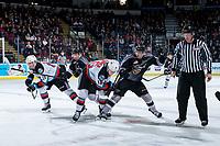 KELOWNA, BC - JANUARY 4:  Evan Patrician #39 of the Vancouver Giants checks Michael Farren #16 of the Kelowna Rockets after the puck drop during second period at Prospera Place on January 4, 2020 in Kelowna, Canada. (Photo by Marissa Baecker/Shoot the Breeze)