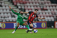 Football - 2020 / 2021 Sky Bet Championship - AFC Bournemouth vs. Preston North End - The Vitality Stadium<br /> <br /> Bournemouth's Lewis Cook holds off the challenge of Daniel Johnson of Preston during the Championship match at the Vitality Stadium (Dean Court) Bournemouth <br /> <br /> COLORSPORT/SHAUN BOGGUST