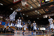 DALLAS, TX - JANUARY 6:  Shaquille Harrison #11 of the Tulsa Golden Hurricane drives to the basket against the SMU Mustangs on January 6, 2013 at Moody Coliseum in Dallas, Texas.  (Photo by Cooper Neill/Getty Images) *** Local Caption *** Shaquille Harrison