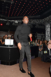 TINIE TEMPAH at a party hosted by Beats by Dre to celebrate the launch of Tinie Tempah's new album and to celebrate his birthday held at DSTRKT, Rupert Street, London on 7th November 2013.