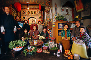In Shingkhey, a remote hillside village of a dozen homes, Nalim and Namgay's family assembles in the prayer room of their three-story rammed-earth house with one week's worth of food for their extended family of thirteen. From the book Hungry Planet: What the World Eats (Model Released)