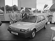 "Nissan Launches New ""Sunny""..1986..21.08.1986..08.21.1986..21st August 1986..Nissan Ireland launched the all new integrated Sunny range on to the Irish market.The launch was the European premiere of this model and marked a significant second phase in the rationalisation of the Nissan Product range. The first Phase was the launch of the Bluebird range in February of this year. The Launch took place at Nissan House, Naas Road Dublin...Posing with the new Nissan ""Sunny"" which was launched today were :(L - R) Mr Tony Kelly,Deputy Managing Director,Mr Gerard O'Toole,Managing Director and Mr Michael Murphy,Sales Director of Nissan Ireland."