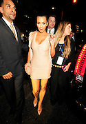 "Kim Kardashina changed clothes after dinner with reggie Bush  and arrives at her big Super Bowl Bash in Miami Friday night with her mom and brother and teh Bush family minus reggie .Paparazzi get to close to comfort while trying to catch a photo of Saints running back Reggie Bush and girlfriend Kim Kardashian. After being a perfect gentleman an escorting everyone into the truck Kim finally tells everyone to ""Back UP"" .... Reggie is Playing on Sunday..New Orleans Saints RB #25 Reggie Bush escorts his girlfriend Kim Kardashian into their chauffered Cadilac Escalade , as the Paparazzi get to close  for comfort and upset him, after having his last meal out with his parents younger brother Jovan and kims mother and brother at Prime 112 on Ocean Drive in Miami before the Big Super Bowl on Sunday, tonight the team had a curfew so he could not attend Kim Super Bowl Bash Leather & Lace Super Bowl Party Friday night Feb 5,2010. Photo©Suzi Altman/SuziSnaps"
