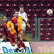 Galatasaray's Juan Pablo PINO (L), Arda TURAN (C) and Trabzonspor's Remzi Giray KACAR (R) during their Turkish superleague soccer derby match Galatasaray between Trabzonspor at the TT Arena in Istanbul Turkey on Sunday, 10 April 2011. Photo by TURKPIX