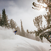Hadley Hammer finds blower storm powder as the sun comes out in the backcountry near JHMR.