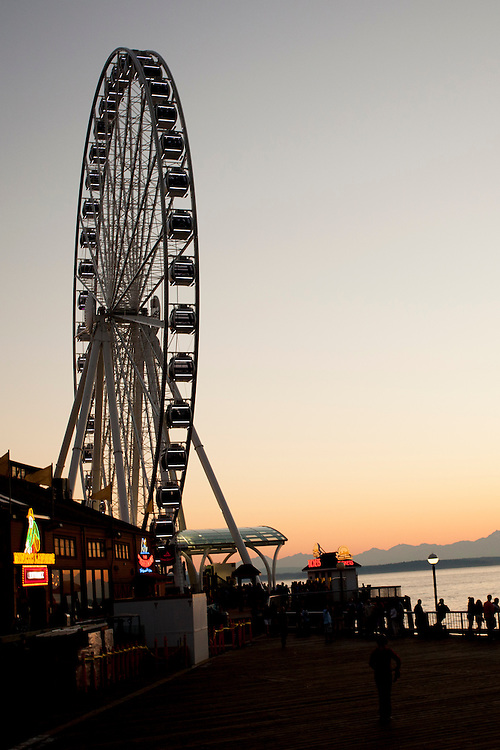 "United States, Washington, Seattle, ""Great Wheel"" ferris wheel, Elliott Bay, and the Olympic Mountains at sunset"
