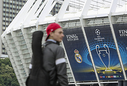 May 13, 2018 - Kiev, Ukraine - A man walks past NSC Olimpiyskiy Stadium covered with banners for the Champions League in Kyiv, Ukraine, May 13, 2018. Kyiv prepares to host UEFA Women's Champions League final between Wolfsburg and Lyon at Valeriy Lobanovskiy Dynamo Stadium on 24 May, 2018 and the UEFA Champions League final match between Real Madrid and  Liverpool at NSC Olimpiyskiy Stadium on Saturday 26 May, 2018. (Credit Image: © Sergii Kharchenko/NurPhoto via ZUMA Press)