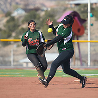 011113      Cayla Nimmo<br /> <br /> Wingate Lady Bears Deianara Billie (right) and Samantha Henry (left) struggle to catch the ball in the in field during the game Thursday afternoon against Rehoboth Christian High School at Fort Canyon Park.