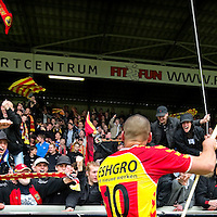 """The Netherlands, Deventer, 13-05-2014. Football, National, Competition, Eredivisie. Joey Suk player of Go Ahead Eagles celebrates the victory over Willem II together with the fans in the """"Adelaarshorst"""", the stadium of Go Ahead Eagles."""