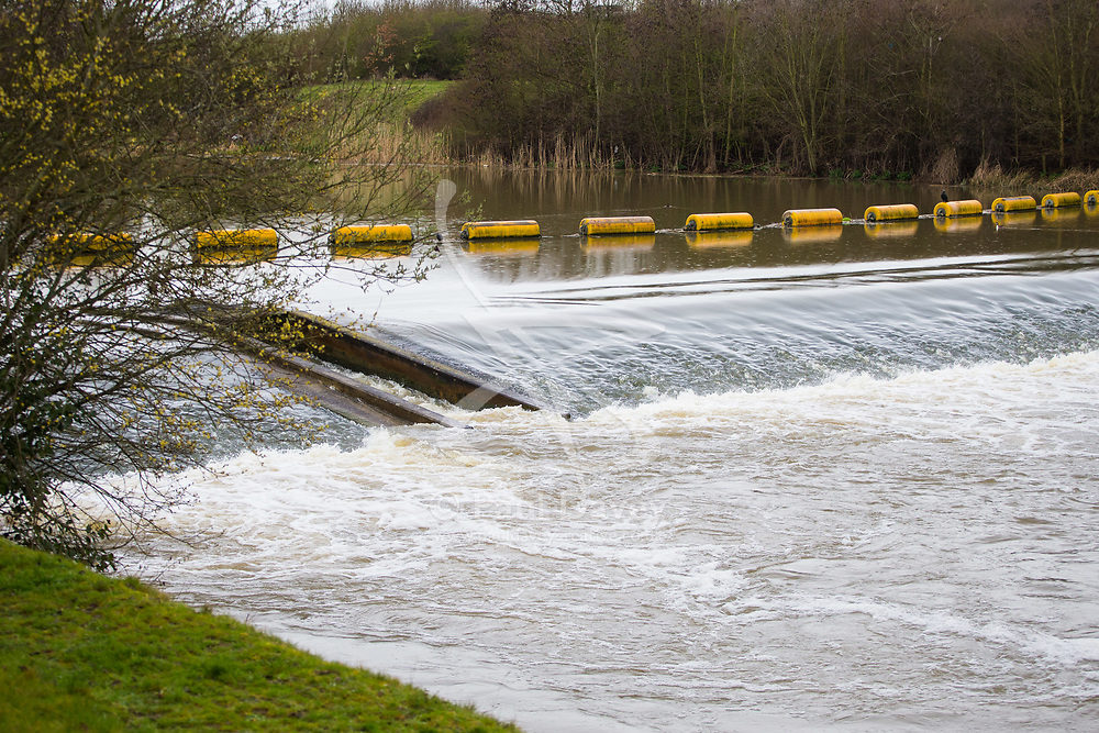Water flows over a weir at the end of the Thames Flood Relief Channel near Windsor as heavy rains in the River Thames catchment area and saturated ground causes the river to rise to within inches of bursting its banks.. April 02 2018.