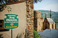 Entrance sign posted outside of the Rheinstein Castle, Trechtingshausen, Germany.