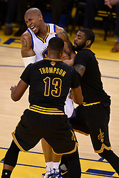 The Golden State Warriors' David West and the Cleveland Cavaliers' Kyrie Irving, right, battle for a ball during the second quarter of Game 5 of the NBA Finals at Oracle Arena in Oakland, Calif., on Monday, June 12, 2017. (Photo by Jose Carlos Fajardo/Bay Area News Group/TNS) *** Please Use Credit from Credit Field ***