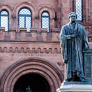 John Smithson Statue and Smithsonian Castle. Statue of John Smithson outside the Smithsonian Castle on the National Mall in Washington DC.