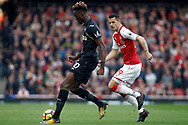 Tammy Abraham of Swansea City (L) holds off Granit Xhaka of Arsenal (R). Premier league match, Arsenal v Swansea city at the Emirates Stadium in London on Saturday 28th October 2017.<br /> pic by Steffan Bowen, Andrew Orchard sports photography.