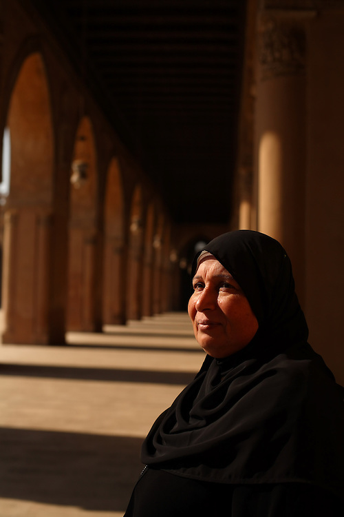 """Magda Hosny Mohammed Ahmed, 53, a breast cancer survivor, is seen in Cairo, Egypt, Sept. 28, 2007. Ahmed was diagnosed with the disease in 2003. She underwent chemotherapy and had her right breast removed. She now uses a bra filled with a gel-like substance or alternately one filled with cotton to hide her procedure. Cancer is still severely misunderstood in many developing countries like Egypt. Ahmed's neighbor became suspicious and ridiculed her when she was diagnosed. """"My downstairs neighbor refused to look me in the eye when I told her I had a tumor. She started yelling and said, 'God is great! God is great! May God protect me! Do not talk to me about this anymore, I don't want you to give it to me too!"""" said Ahmed."""