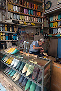 Making leather slippers inside the ancient Medinah of Fes
