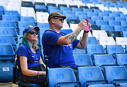 Two Chelsea fans take their seats early and take pictures before kick off