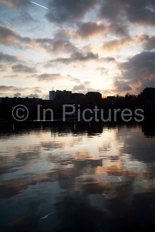 Reflection of a dramatic evening sky in the water at Shadwell Basin, East London.