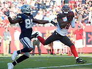 Tampa Bay Buccaneers free safety Bradley McDougald (30) intercepts a pass intended for Dallas Cowboys wide receiver Dez Bryant (88) during the second half of an NFL football game in Tampa, Fla., Sunday, Nov. 15, 2015. The Buccaneers won 10-6. (Phelan M. Ebenhack for the Associated Press)