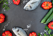 Food background with fish and vegetables, top view.