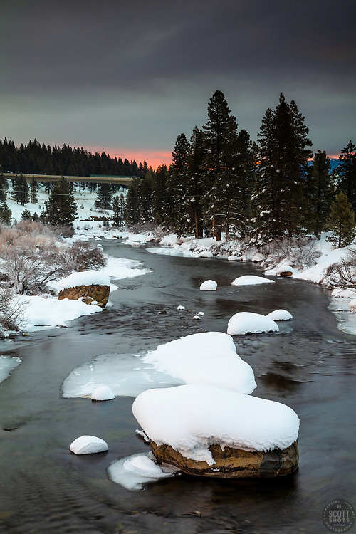 """""""Snowy Truckee River Sunrise 1"""" - Photograph of snow covered boulders on the Truckee River, shot from the Robert """"Doc"""" Affeldt Memorial Bridge at sunrise."""
