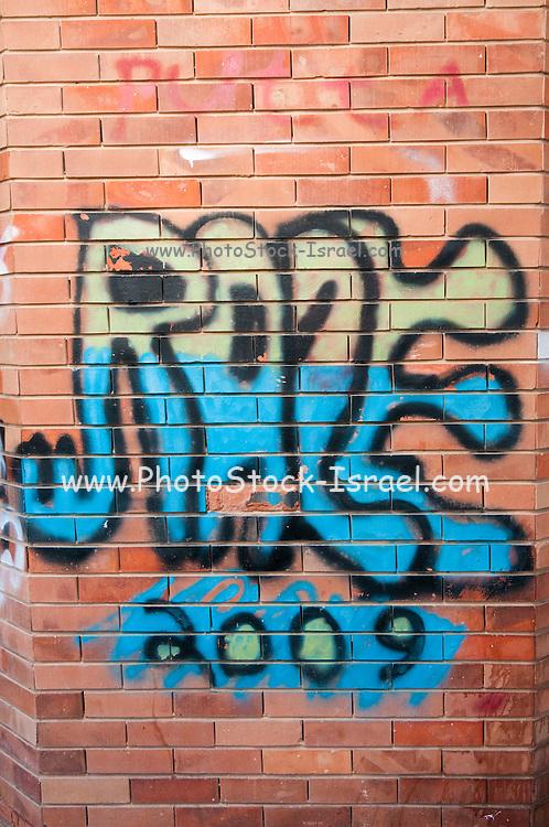 Brick wall with graffiti background