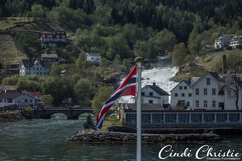A ferry ride from Geirangerfjord approaches Hellesylt, Norway, on the Sunnylvsfjorden, on May 18, 2013.  Geirangerfjord is among UNESCO World Heritage sites.  (© 2013 Cindi Christie)