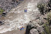 Medium view from above of two rafts on the Rio Grande River