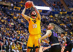 Mar 20, 2019; Morgantown, WV, USA; West Virginia Mountaineers guard Jermaine Haley (10) shoots during the second half against the Grand Canyon Antelopes at WVU Coliseum. Mandatory Credit: Ben Queen
