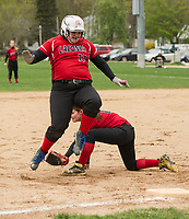 Marti Milan of Stevens makes the tag at third base on Morgan Romprey of Laconia during NHIAA Division III softball Tuesday afternoon.   (Karen Bobotas/for the Laconia Daily Sun)