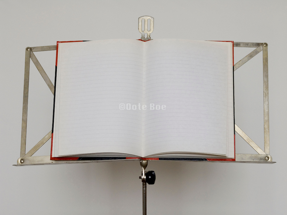 music stand with an open note book