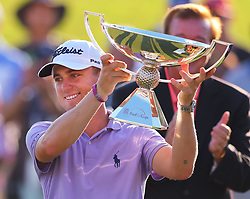 September 24, 2017 - Atlanta, GA, USA - Justin Thomas is presented the FedEx Cup on the 18th green at the conclusion of the Tour Championship at East Lake Golf Club in Atlanta on Sunday, Sept. 24, 2017. (Credit Image: © Curtis Compton/TNS via ZUMA Wire)