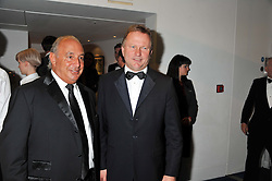 Left to right, SIR PHILIP GREEN and NICK JONES at the GQ Men of The Year Awards 2012 held at The Royal Opera House, London on 4th September 2012.