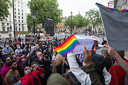 London, UK. 23rd June, 2021. Campaigners against LGBT+ conversion therapy attend a picket outside the Cabinet Office and Government Equalities Office. Represented by Peter Tatchell, Revd Colin Coward and Jayne Ozanne of the Ban Conversion Therapy Coalition, they also handed in a petition signed by 7,500 people calling on the government to fulfil its 2018 promise to ban LGBT+ conversion therapy.