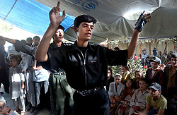 KABUL,AFGHANISTAN - AUGUST 29:  Afghan boys mimic Michael Jackson while they dance during an engagement ceremony, August 30, 2002 in Kabul, Afghanistan. Each Friday, every beauty salon is filled with  brides, the hotels are jammed with young couples and most streets are packed with streams of cars, blaring their horns as Afghans rush to get married after decades of war. (Photo by Ami Vitale/Getty Images)
