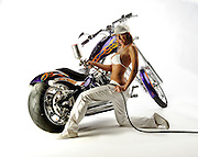 Model Crystal Peake painting a Big Dog motorcycle customized by Tommy Bolton