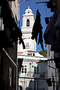 Narrow streets and São Miguel church at the Alfama district, on the way of Lisbon's nº28 yellow tram, through the central, most historic region of the city.