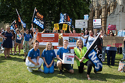 London, UK. 20th July, 2021. NHS workers from the grassroots NHSPay15 campaign pose before a march from Parliament to 10 Downing Street to present Matthew Tovey's petition signed by over 800,000 people calling for a 15% pay rise for NHS workers. At the time of presentation of the petition, the government was believed to be preparing to offer NHS workers a 3% pay rise in 'recognition of the unique impact of the pandemic on the NHS'.
