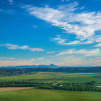 The Bears Paw Mountains rise behind the Missouri River Breaks and ranch pastures along the Missouri River in north central Montana.