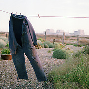 paint splattered denim jumper drying on a clothes line outside